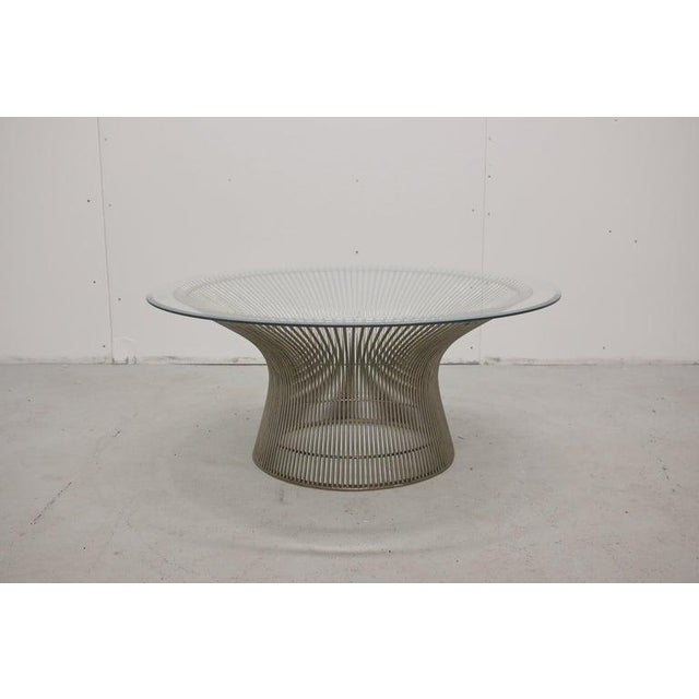 An original Warren Platner coffee table for Knoll. Steel frame and beveled glass top. Good vintage condition with minor...