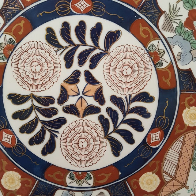 Up for auction is a gorgeous oversized Japanese Charger. The plate is Imari Porcelain from Japan's Meji period. This is an...