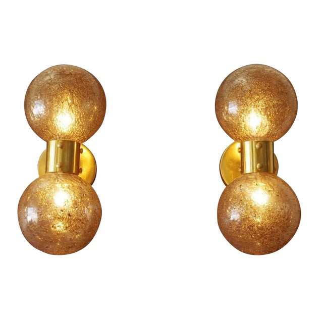 Limited edition Italian modern wall sconces with clear Murano glass globes with smoky bubbles and polished brass frame by...