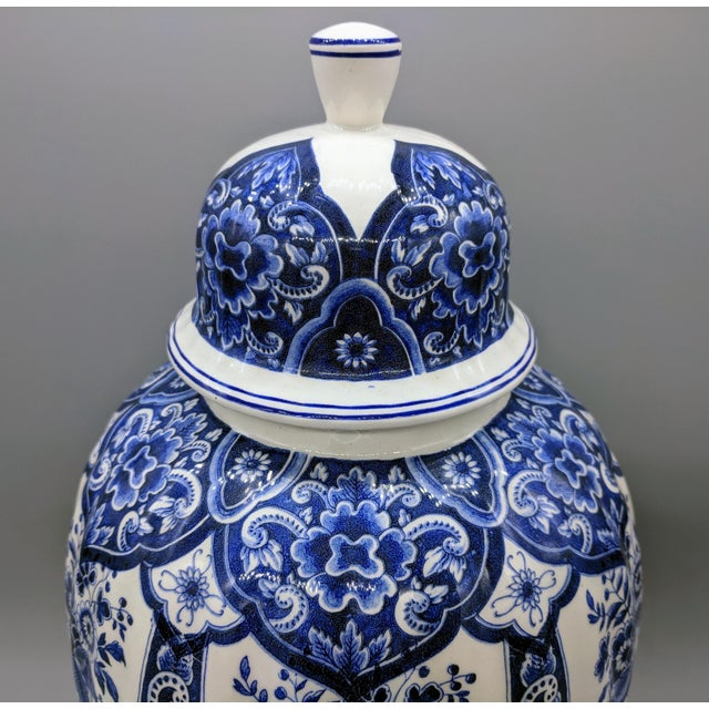 Large ginger jar beautifully patterned with deep blue flowers and scrollwork. Would look lovely in a collection of blue...