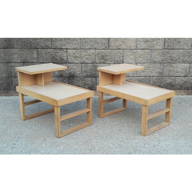 A pair of Paul Laszlo style blonde wood stepped end tables with laminate tops. These vintage tables are solid, sturdy and...