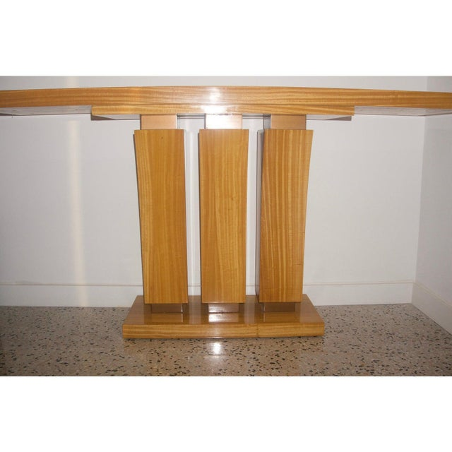 This stylish Art Deco inspired console table inspired by Karl Springer is fabricated in satinwood with a clear lacquer...