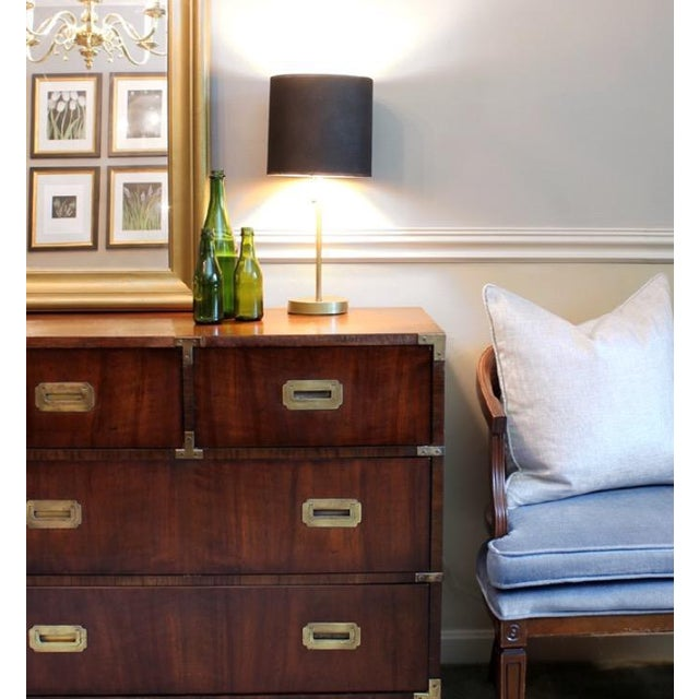 Iconic vintage Henredon campaign chest for sale. The original walnut dresser is complete with brass hardware and pulls and...