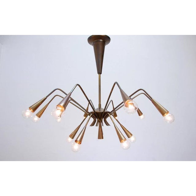 Fifteen-arm chandeliers by Lumi of Italy. Original naturally aged patina finish. Rewired for use in the US. E14 candelabra...