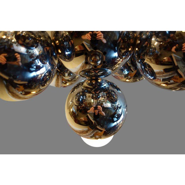 """This is a midcentury eight light atomic chrome Sputnik chandelier. Measure: Drop height is 27.5""""."""
