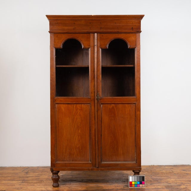 Wood Antique Dutch Colonial Tall China Cabinet With Glass Doors and Arched Motifs For Sale - Image 7 of 13