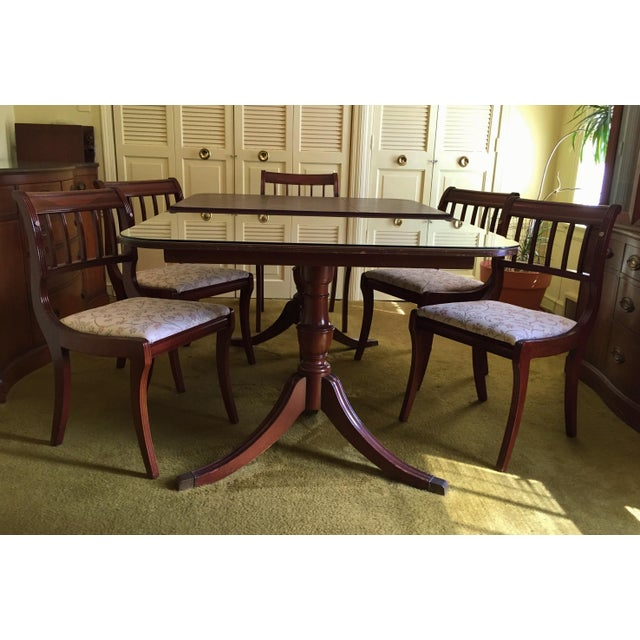 Constructed of solid mahogany, this handsome two-pillar Regency-style dining table was made by Henredon for their iconic...