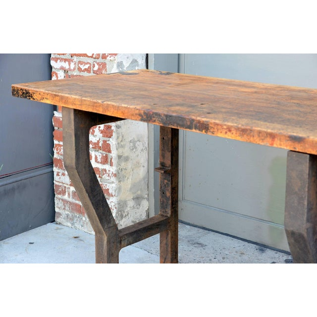 Massive Patinated Industrial Console. The base attaches to the wall and/or the floor.