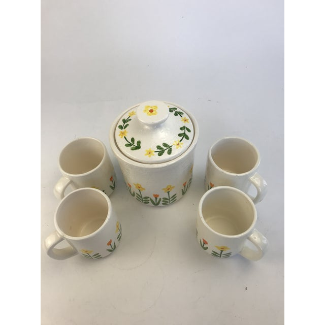 This is a sweet hand-painted set of coffee cups and a covered canister. This came from the home of a glassware collector....