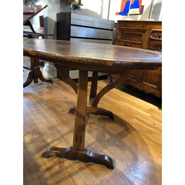 Unusually fine Charles X French Provincial tilt-top wine table made predominantly of richly patinated walnut and oak with...