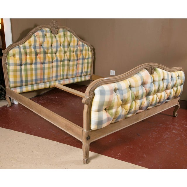 A king-sized Louis XV style country French bed. Custom quality by Don Rousseau, This fun checkered upholstered in light...
