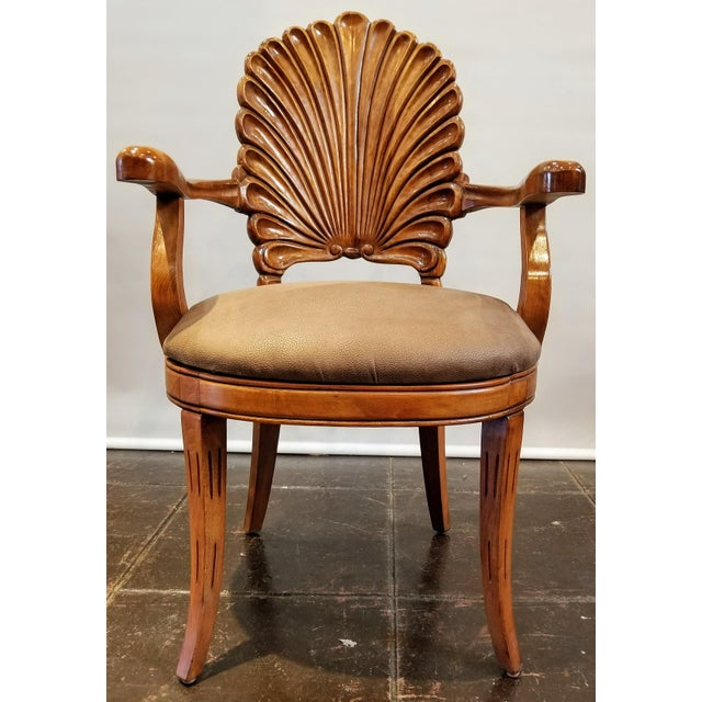 Mid-century (1960s-1970s) carved wood shell-back Venetian grotto armchair from Italy. The design was inspired by the...