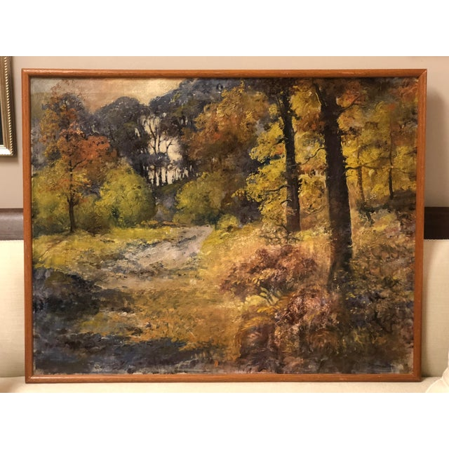 This vivid rendition of a forest clearing in early Autumn dates from the early 20th century. The work is framed in a...