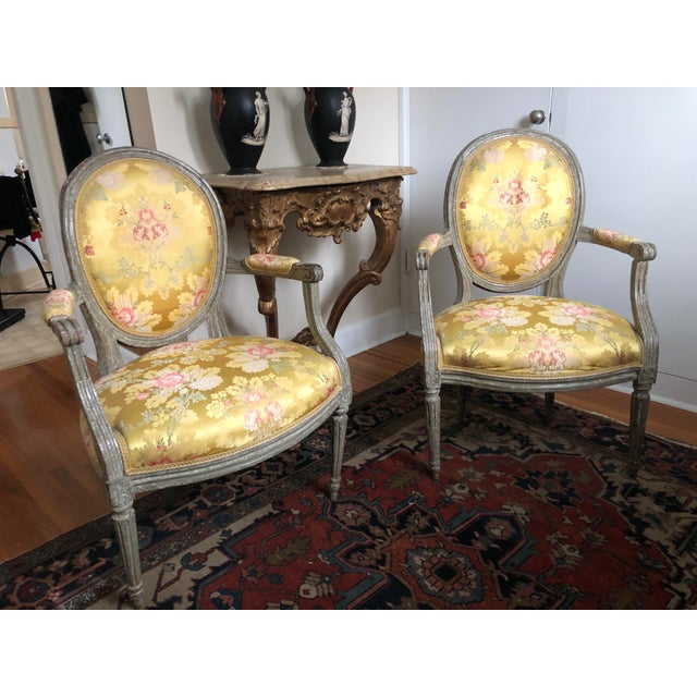 Pair of 18th Century Circa 1760s Louis XVI Fauteuil Chairs. Original Paint! The paint has aged wonderfully of the...