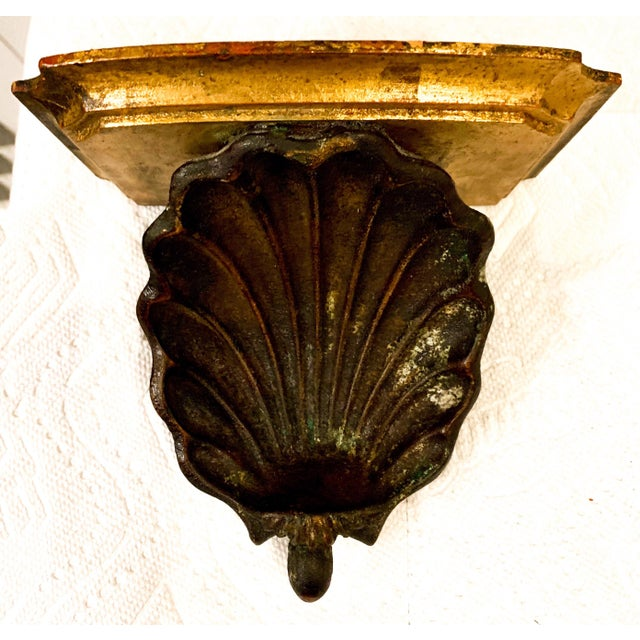 Pair of carved shell Palladio wall brackets in very good vintage condition. The shell is an ebony paint, and the remainder...