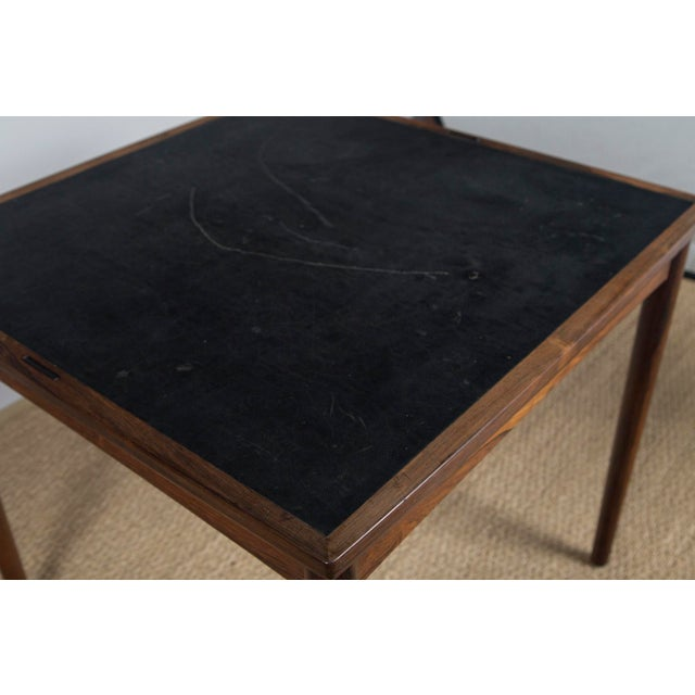 Scandinavian Modern draw-leaf rosewood game table designed by Poul Hundevad paired with four Scandinavian Modern rosewood...