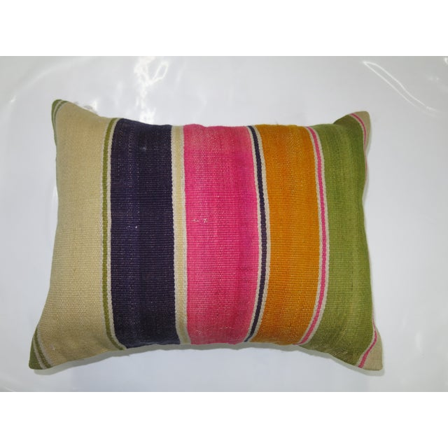 Pillow made from a Mid-century kilim with cotton back. Zipper closure. Foam Insert Included.