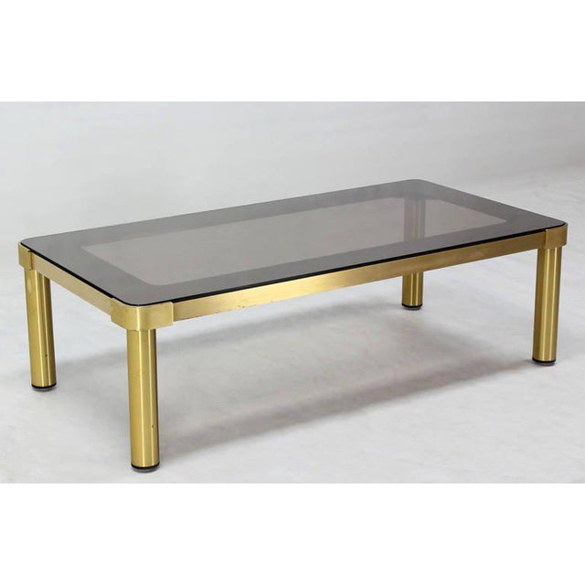 Very nice quality brass and glass coffee table attributed to Mastercraft.