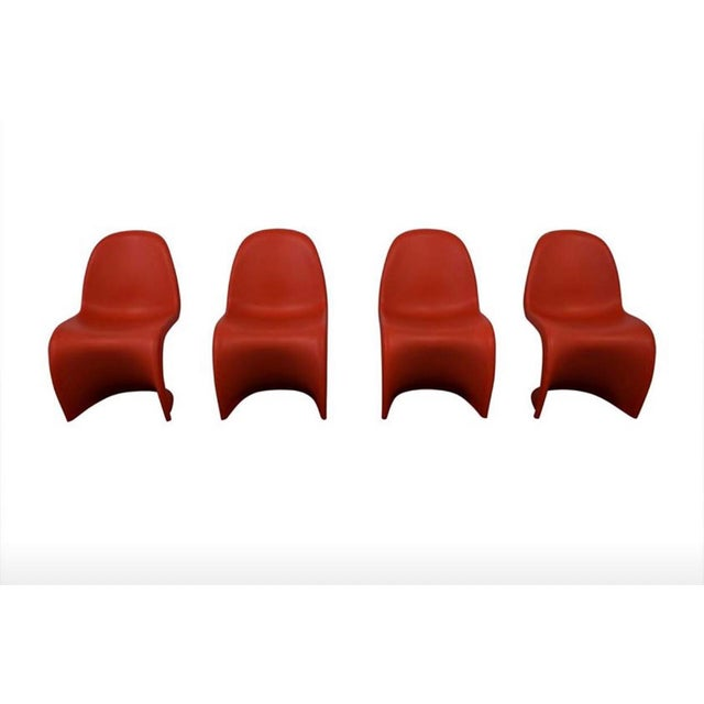 Fab set of 4 cherry red Panton chairs. Ergonomically pleasing, very comfortable. Stamped Vitra & signed Verner Panton. I...