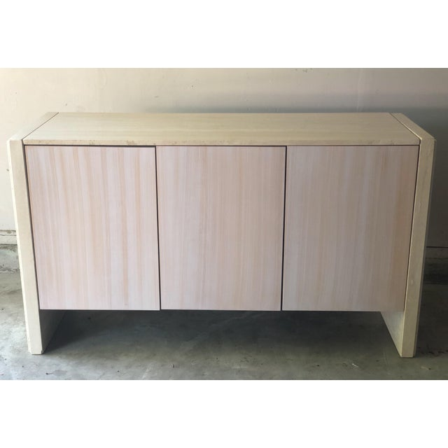 Beautiful simple and classic Italian design 3 cabinet buffet by Stone International. Natural light wooden finish doors...
