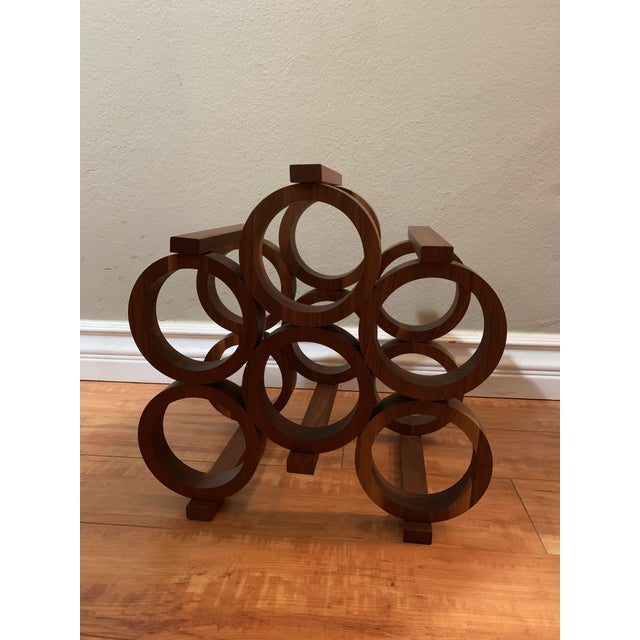 Mid-century Kustom Kraft tabletop wine rack. This solid Walnut six bottle wine rack features a modern shape with circular...