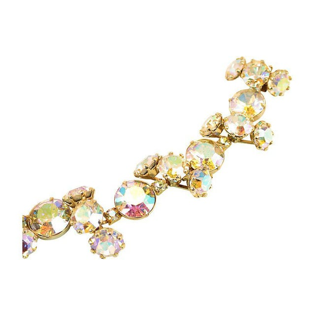 Offered here is a Vogue gold-plated bracelet and matching clip-back earrings from the 1950s. The three-dimensional off-set...