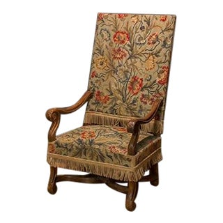 French Needlepoint Begere Chair With Nail Head Trim and Fringe Accent. For Sale
