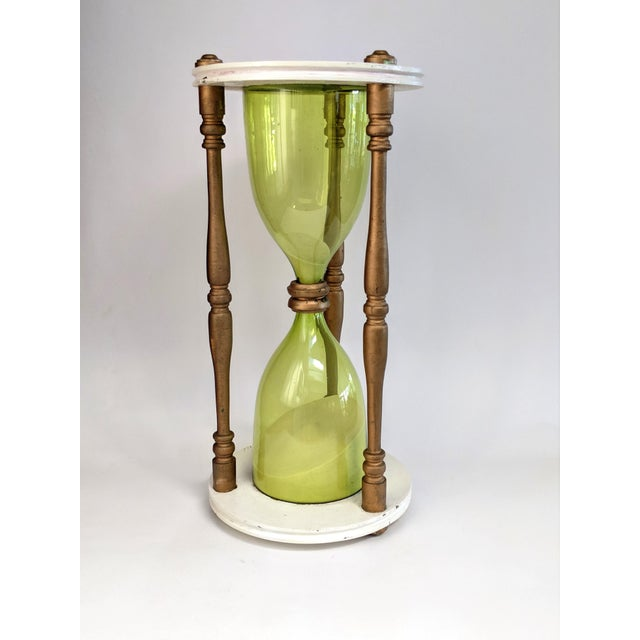 Working hourglass timer sculpture made of wood, sand, and green glass. In very good original condition. Timer is for 2 hours
