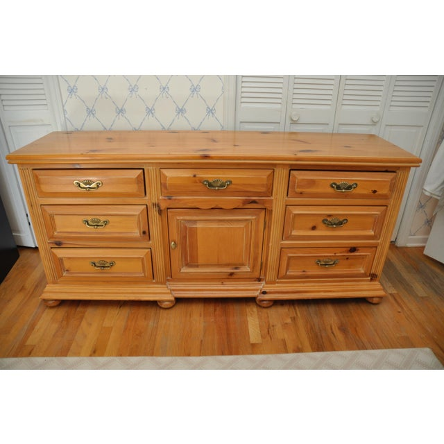 Link Taylor wide dresser by Lexington Furniture features seven drawers with one center cabinet, perfect for all your...