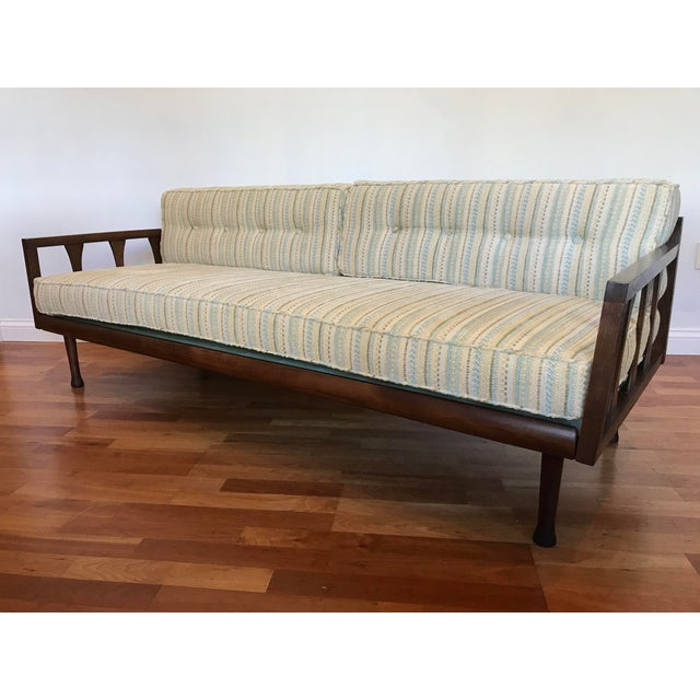 Danish in style clean solid Walnut frame restored new upholstered chenille fabric that delivers a 1960s flavor. Seat...