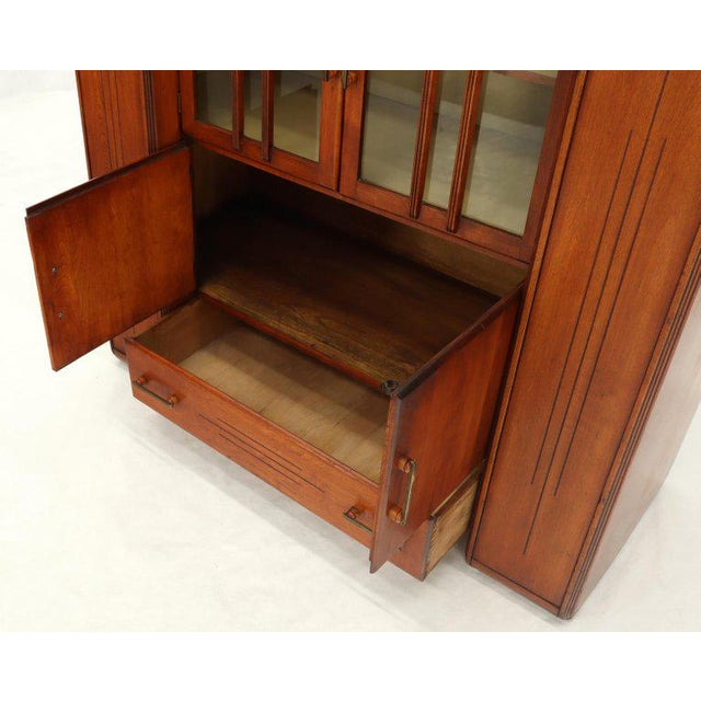 Very unusual multi purpose Art Deco storage cabinet with lid top compartments, back splash, double glass doors, and...