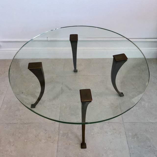 Stunning coffee table with four patinated bronze legs and original 1940's glass top showing some age appropriate wear with...