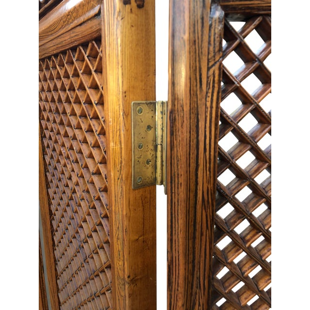 Early 19th century hand carved elm wood room divider. Full lattice fretwork panels with carved geometric design on panels...