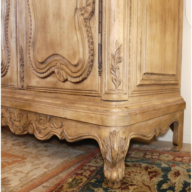 Ferguson Copeland French Country armoire. Features finely carved details with a double bonnet top. Double doors butterfly...