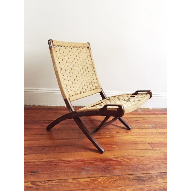 Amazing Mid-Century folding jute rope chair. Vintage Hans Wegner Yugoslavian style chair with walnut legs. The chair can...