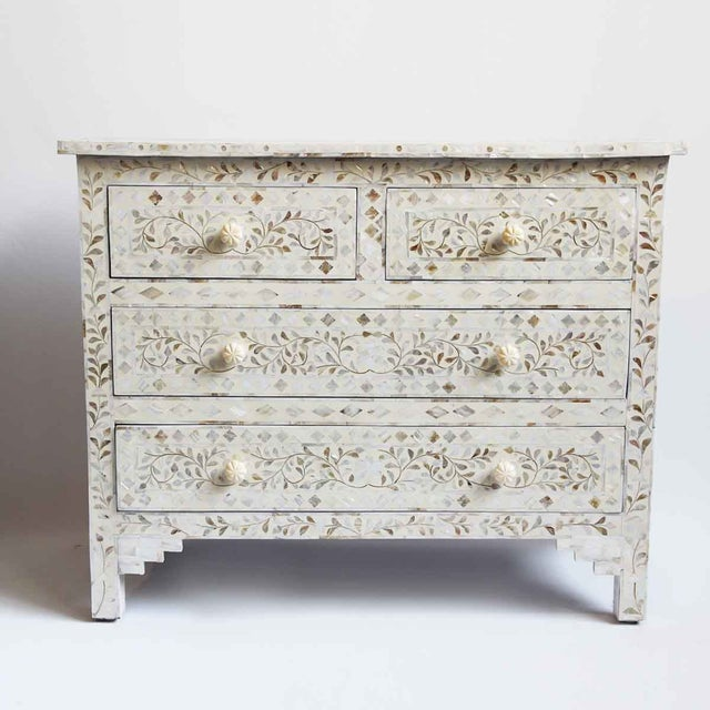 Intricate hand carved mother of pearl inlay dresser. Beautiful floral patterns with off white cream ground color. Four...