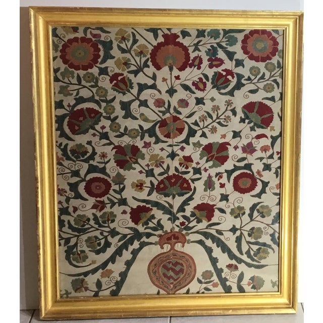 Exceptional hand embroidery suzani textile, professionally framed in antique gold leaf wood frame and protected with...