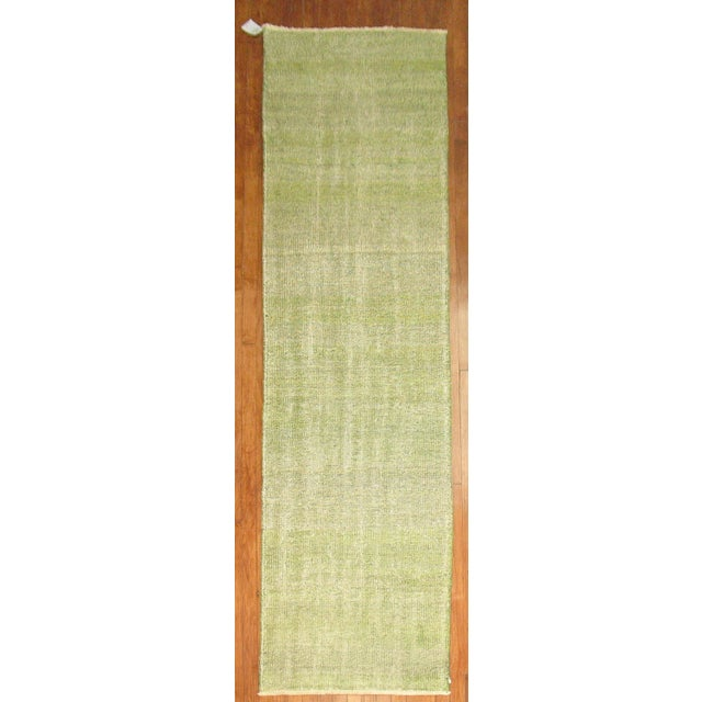 Rare vintage Turkish runner. Over-dyed in a lovely soft green color. Awesome pop of color that doesn't overwhelm your...