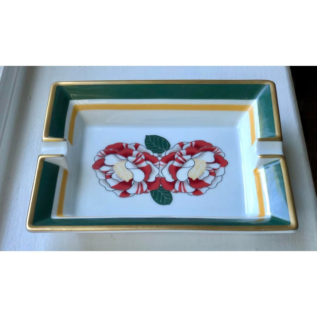 Hermes porcelain cigar ashtray. White with hunter green, mustard yellow and gilt gold trim