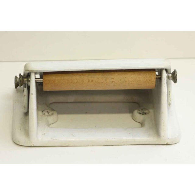Porcelain over metal white toilet paper holder. Some wear from age and use. Priced each.
