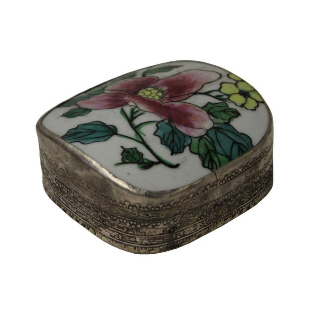 This is a hand made nickel metal trinket box in irregular shape with old recovered colorful flower porcelain part inset on...
