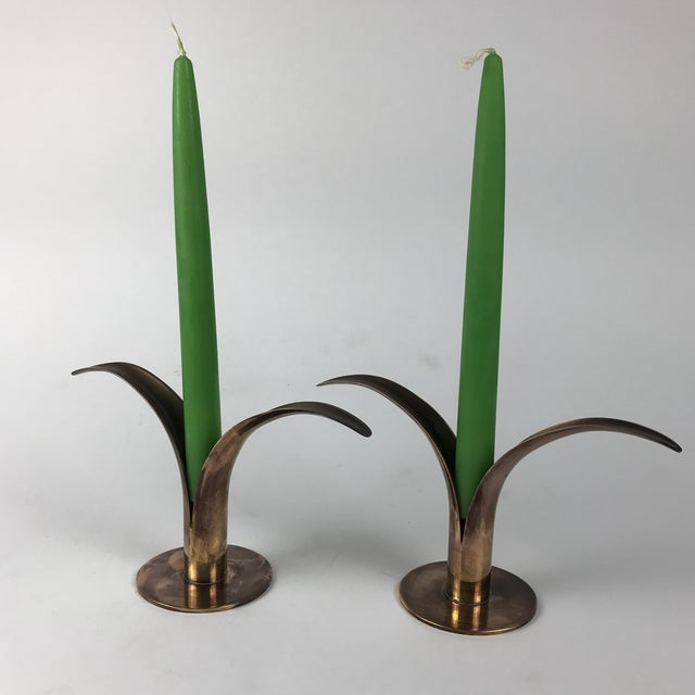 Gorgeous pair of Mid-Century brass candlesticks from Sweden stamped Ystad-Metall on the bottom. This is a matching set of...
