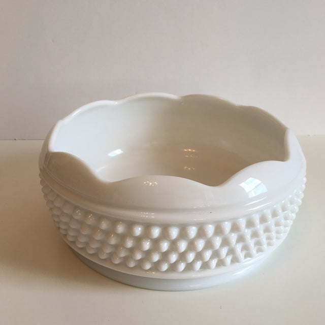 Lovely scalloped rim hobnail milk glass bowl, perfect for fruit or general catchall. A classic piece. Piece is in great...