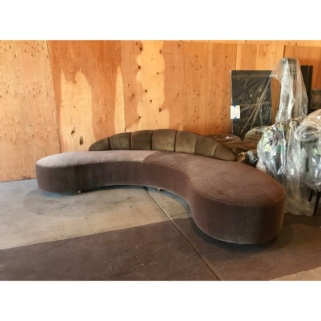 Custom ordered Vladimir Kagan-style freeform curved sofa; brown mohair seating with color-matched metallic leather...