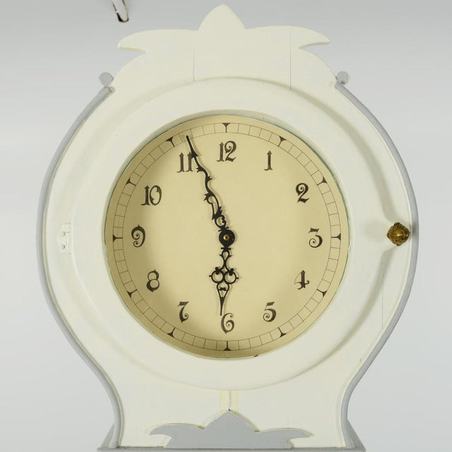 Hand painted Swedish Mora clock made in the 1990's with modern mechanism Internal shelves for storage inside the clock...