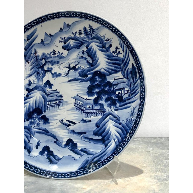 A large 19th Century Japanese Imari blue and white charger, Meiji Period
