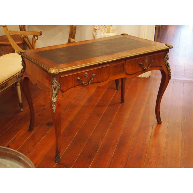 A Regence style writing table, of slightly smaller proportions that the norm and having its original leather to. The pied-...