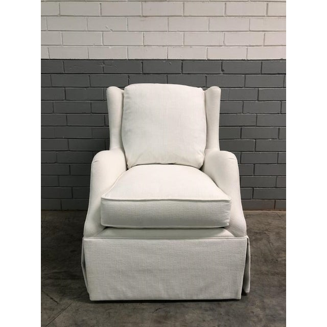 The Rachel Skirted Swivel Chair is a first quality sample that features a White fabric with a Kick Pleat skirt.