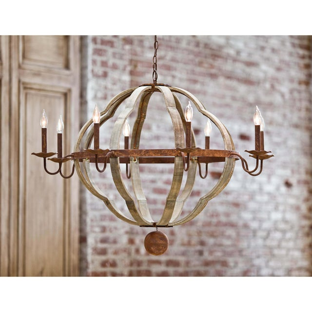 A distressed Beach Wood finish on this quatrefoil chandelier brings a coastal element to your decor. The rustic frame,...