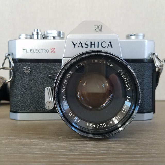 A vintage classic Yashica TL Electro 35mm film camera with a fabulous adjustable neck strap made of cotton velvet with...